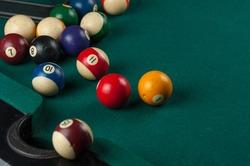 Billiards balls and cue on billiards table. Billiard sport concept