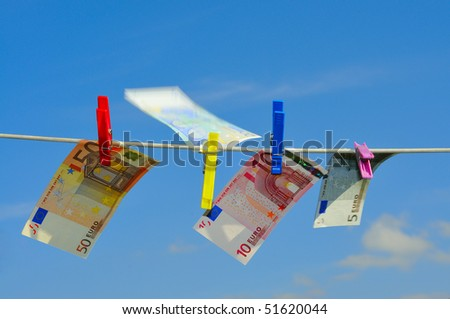 Bills on a clothesline blowing in the wind.