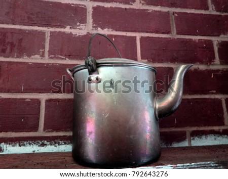 Billy boiled tea pot on a shelf #792643276