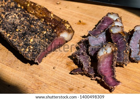 Biltong - Traditional South African Jerky made from beef or game meat, cured and dried with salt and spices; eaten uncooked, often as a snack. Stock photo ©