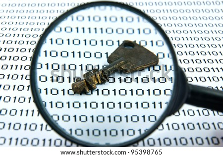 Binary code and key seen by magnifying glass