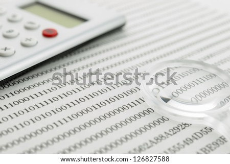 Binary code and magnifying glass, calculator