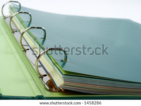 Binder closeup with files stacked (small DOF)