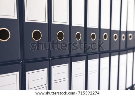 Binder folders in shelf, binders in a row. #715392274