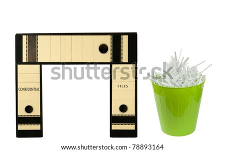 binders resembling a desk with files and a green bin with shredded paper on a white background