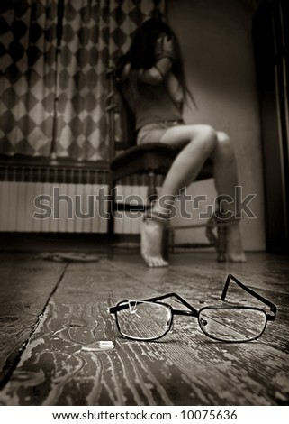 Bindfloded girl for chair in old room