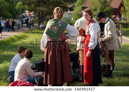 BINGSJO, SWEDEN - JULY 3: The traditional folk music festival on July 3, 2013 in Bingsjo. The festival is held annually on the first Wednesday in July and attracts thousands of musicians and visitors.