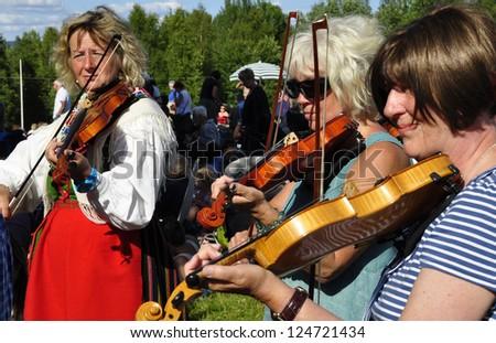 BINGSJO, SWEDEN - JULY 6: unidentified people in music festival at Bingsjostamman in Bingsjo, Official name Bingsjostamman organization are folkmusikens hus on July 6, 2011in Bingsjo Sweden