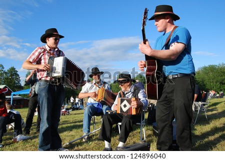 BINGSJO, SWEDEN - JULY 2: Unidentified people in music festival at Bingsjostamman in Bingsjo, official name Bingsjostamman organization are folkmusikens hus on July 2, 2008 in Bingsjo Sweden