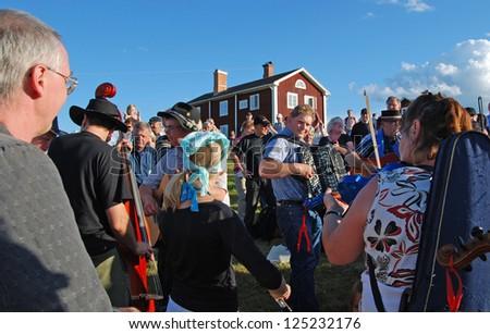 BINGSJO, SWEDEN - JULY 7: Unidentified people in music festival at Bingsjostamman in Bingsjo, official name Bingsjostamman organization are folkmusikens hus on July 7, 2010 in Bingsjo Sweden
