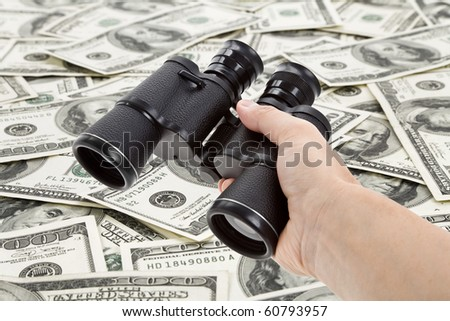 Binoculars and dollar, concept of Business success