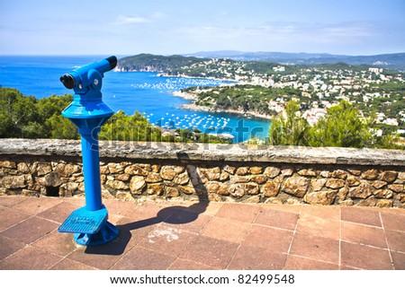 binoculars at the viewpoint overlooking Calella and Llafranc - stock photo