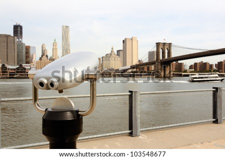 binoculars for sightseeing from Brooklyn towards Lower Manhattan in New York City - stock photo