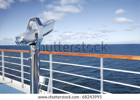 Binoculars looking  at the horizon on the deck of cruise