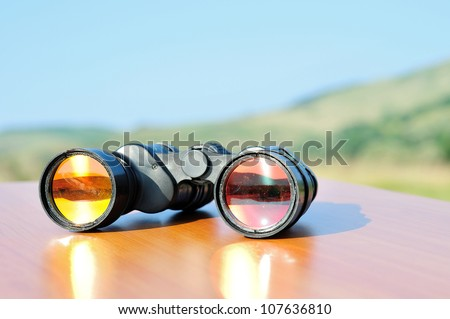 Binoculars on table in nature