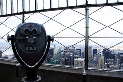 Binoculars viewing over Manhattan from Empire State Building, in New York