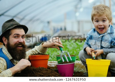 bio food production. bio food production industry. father and son are happy because of use bio food production. bio food production concept. we like spending time together