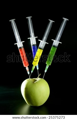 Bio genetics research of food , apple manipulation with syringe
