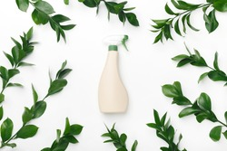 Bio organic. Eco Cleaning spray. Bottle with spray nozzle and green leaves on white background, spring cleaning