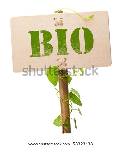 bio sign message on a wooden panel and green plant - image is isolated on a white background