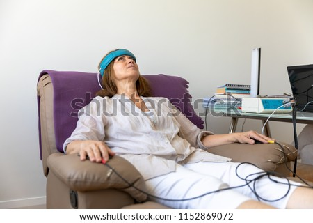 Biofeedback Patient Being Tested by Doctor #1152869072