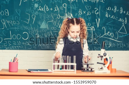 Biology equipment. biology education. Little kid learning chemistry in school lab. Happy child girl. Biology lesson. students doing biology experiments with microscope in lab. Testing your blood.