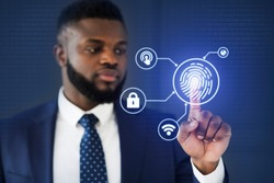Biometric Authentication. African American Businessman Touching Virtual Panel For Fingerprint Scanning Over Blue Background. Selective Focus