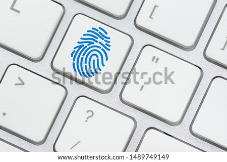 Biometric authentication and access control, security concept : Fringerprint symbol on a surface of a white keyboard, fingerprint is an impression left by friction ridge of human finger, it is unique #1489749149