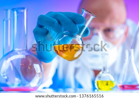Biometric examination in England. The expert mixes the chemicals. Chemical examination of biomaterial. DNA analysis in United Kingdom. Forensic medical expertise. DNA inspection.