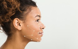 Biometric facial verification. African American woman with scanning grid on her face against light background, panorama with empty space