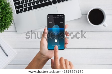 Biometric Identification. Woman Unlocking Smartphone Scanning Fingerprint With Personal Verification App At Workplace Indoor, Top View. Phone Authorization Concept. Collage, Cropped Foto stock ©