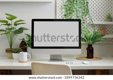 Biophilia workspace in home office room with computer, supplies, decorations and plants house