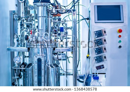Bioreactor. Cultivation of microorganisms in the bioreactor. Laboratory fermenter. Microbial fermentation. The creation of drugs. Microbiology. Biotech industry. Pharmacology.