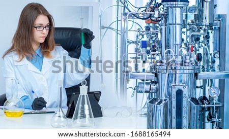 Bioreactor. Cultivation of microorganisms in the bioreactor. Laboratory fermenter. Microbial fermentation. The creation of drugs. Microbiology. Biotech industry. Pharmacology. Pharmacological study.
