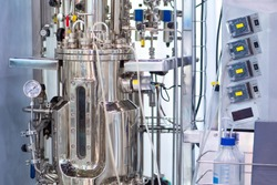 Bioreactor. Cultivation of microorganisms in the bioreactor. The creation of drugs. Microbiology. Biotech industry. Pharmacology. Laboratory fermenter. Microbial fermentation.