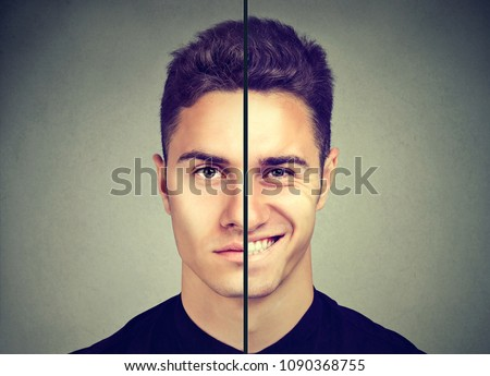 Bipolar disorder. Man with double face expression isolated on gray background Foto stock ©