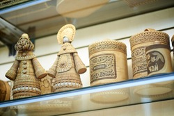 Birch bark products: dolls, croup bags. Russian inscriptions: semolina, peas, tea