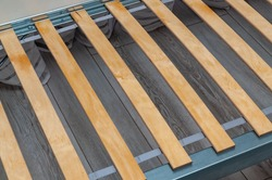 birch slats on the metal frame of the bed. High quality photo