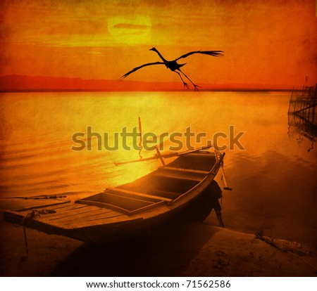 bird and old fish-boat on sandy beach with beautiful sunset on old grunge antique paper texture