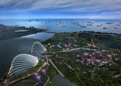 Bird eye of Landscape from bird view of Cargo ships entering one of the busiest ports in the world, over the Garden by the bay in Marina bay sand