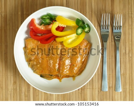 Bird eye view of salmon fillet in curry