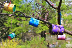 bird feeders made of old tin cans