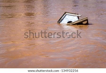 Bird house drown by a flood.