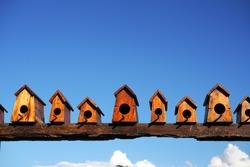 Bird house nesting on blue sky background. copy space