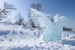 Bird ice sculptures. Ice sculptures in the snowfield.