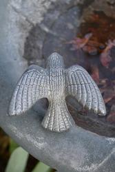 Bird ornament on a bird bath