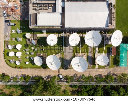 Bird's-eye view from drone of Satellite Dish, Satellite communication and satellite dish at Daytime city background / Plains - Telecommunication tower Antenna #1078099646