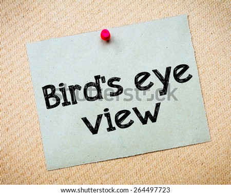 Bird\'s eye view Message. Recycled paper note pinned on cork board. Concept Image