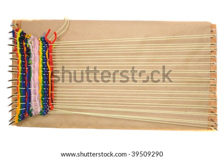 bird's eye view of a Weaving Loom isolated on a white background.
