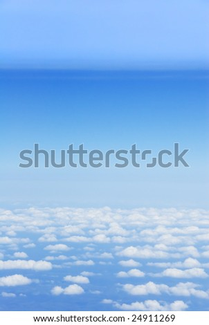 Bird?s eye view of clouds and light blue earth atmosphere layers